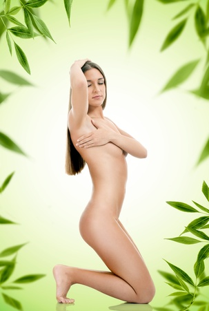 nude female figure: Naked perfect body of beautiful young woman,  on green background