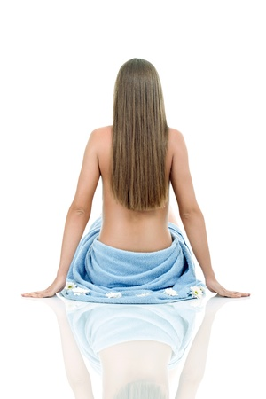 Woman naked back hairs and blue towel, isolated on white background photo
