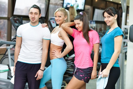 group of young people in modern gym  photo