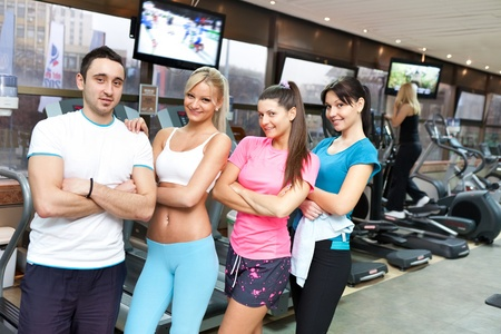 group of young healthy people in gym photo