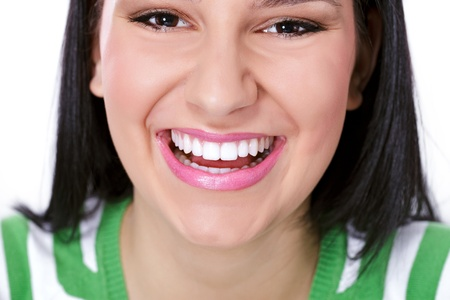 Young woman with perfect teeth  laughing, close up  photo