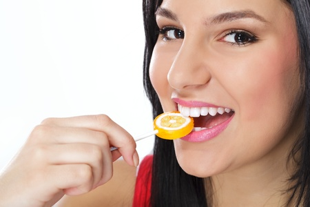 Lollypop in perfect woman teeth Stock Photo - 12781399