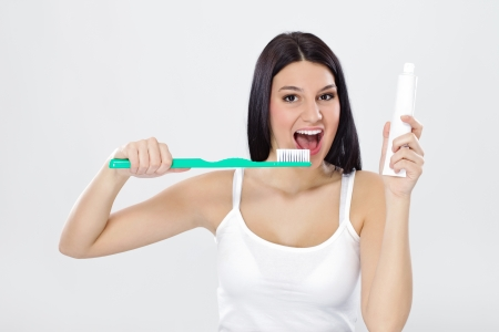 Beautiful girl holding toothpaste and brush, ready for brushing Stock Photo - 12781300