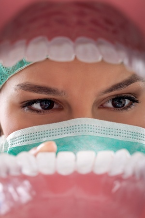 dental doctor: dentist examining teeth view  from open mouth Stock Photo