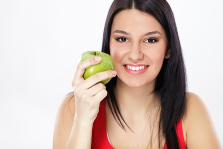 young helthy woman holding fresh green apple photo