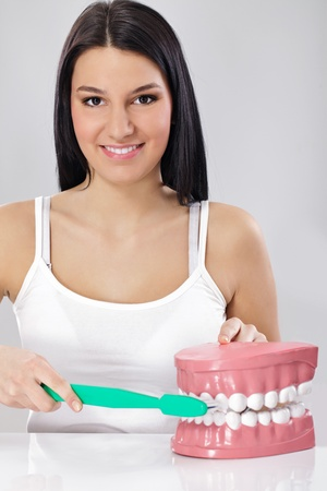 Woman with toothbrush and jaws , brushing teeth the right way photo