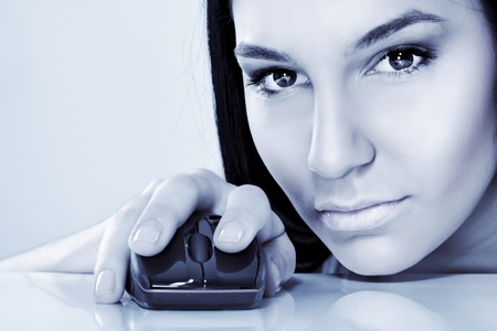 cyber girl with computer mouse Stock Photo - 12939133