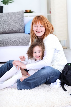 changed: mother  fixing jeans her daughter  Stock Photo