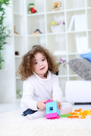 Little girl playing with blocks Stock Photo - 12939099