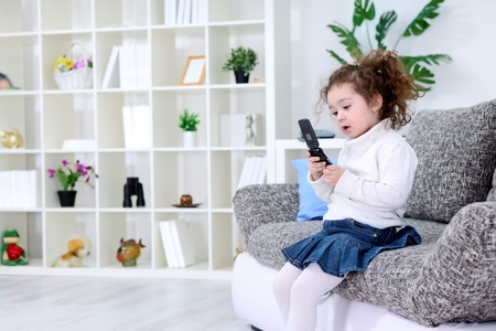 video call:  Little girl using smart phone Stock Photo