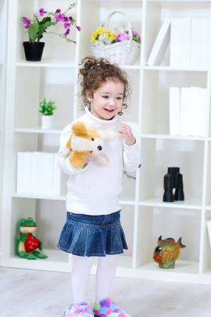 smiling little girl with toy Stock Photo - 12937998