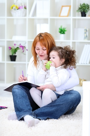 Happy family, mother and daughter have fun together Stock Photo - 12938866