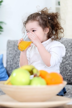 trusty:  trusty little girl drinking fresh juice Stock Photo