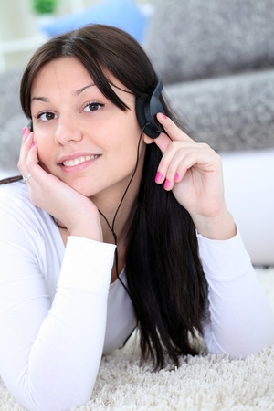 Teenager girl  with  headphones  enjoying in music  photo