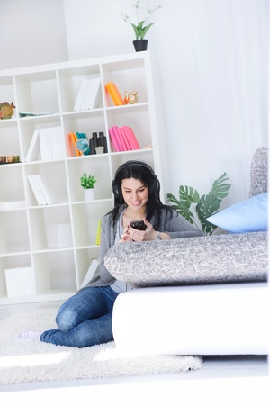 Young woman choosing music over the smart phone photo