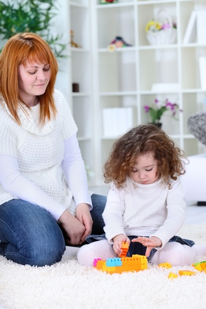 mother  and daughter playing with toys together photo