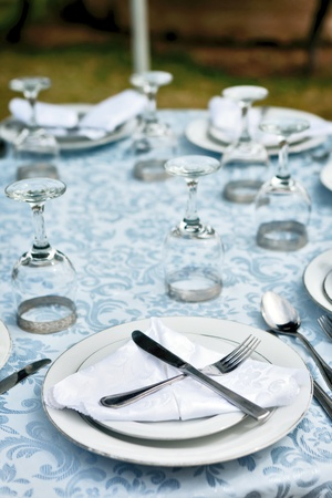 perfectly decorated table setting with wine glass photo
