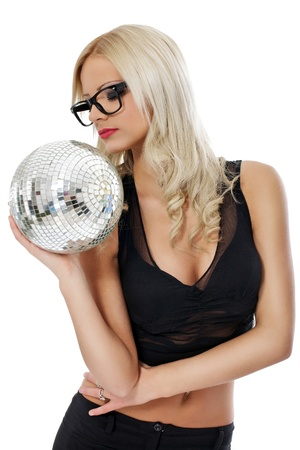 sensual young blond holding disco ball over gray background photo