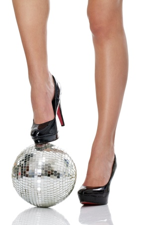 legs in black  high heel with disco ball, isolated on white background