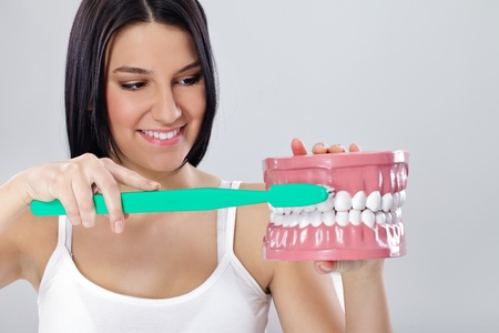 young woman with big toothbrush and jaws photo