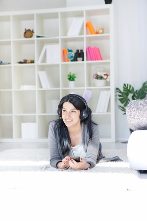 Girl relaxing and listening music Stock Photo - 13524821