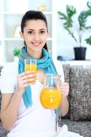 Smiling girl holding pitcher of homemade juice Stock Photo - 13524778