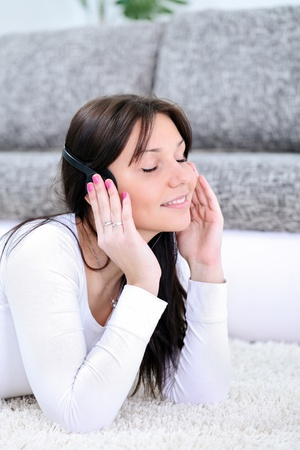 beautiful young girl  with closed eyes enjoying in music  Stock Photo - 13524803