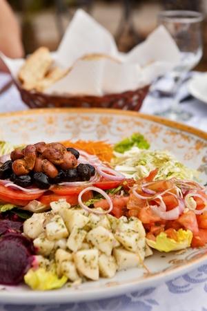 Traditional Moroccan dish - carrots, potatoes, onions, garlic, beans, beets… photo
