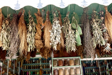 Dry herbs hanging on market in Marrakesh photo