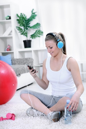 Teenager girl listening music resting after exercising photo