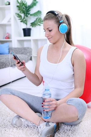 young attractive girl relaxing after exercising photo