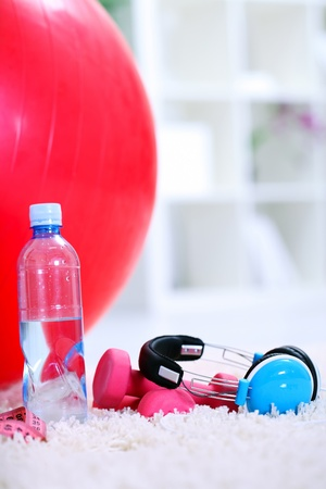 bottle of water, Pilates ball  and dumbbells,  equipment for exercise photo