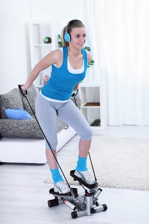 cardio fitness:  Teenager girl exercising on stepper trainer