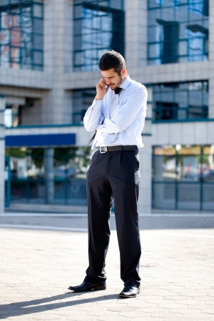 picture of handsome businessman with cell phone photo