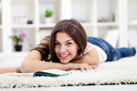 Smiling teen girl lying on floor and relaxing photo