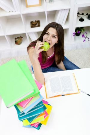 Teenager girl having break for snack Stock Photo - 13888277