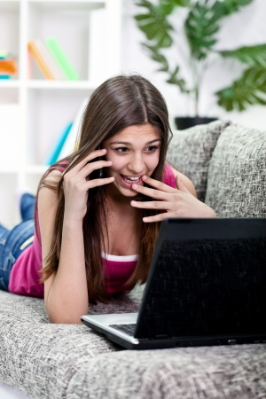 praised: Excited girl talking with a friend and praised her for a boyfriend from the net Stock Photo