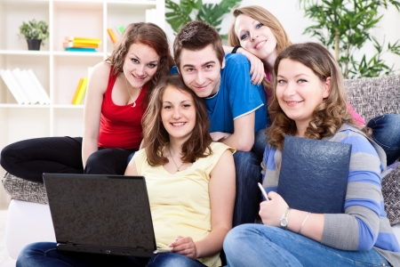 group network:  group of teens  learning together with laptop