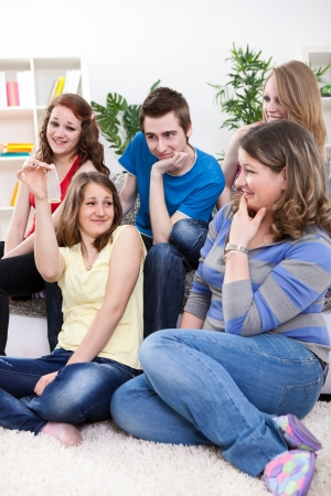 sex education: Group of young teenagers having discussion about protection, sex education