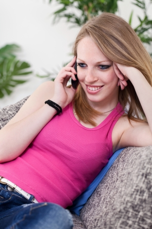 Beautiful girl talking on the phone , gossipy girl Stock Photo - 13888232