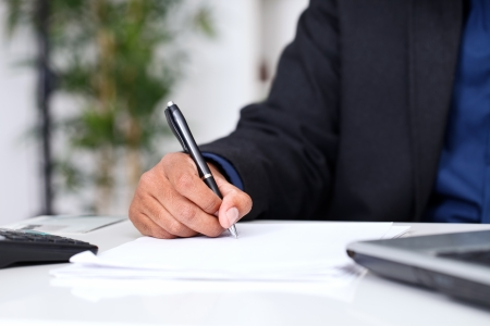 Close-up of a businessman's hands with pen signing document Stock Photo - 13888050