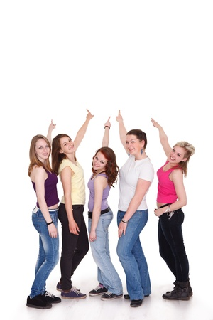 back up: Group of five girls in a row pointing to copy space  Stock Photo