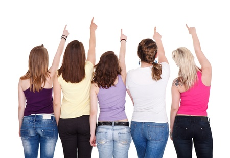 jeans girl:  Young girls pointing in copy space and looking up, back view