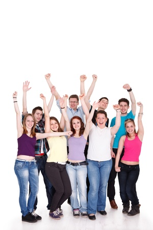 arm outstretched: Excited young students with hands raised standing on white background