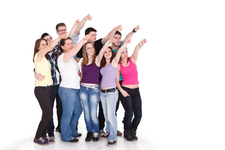 advert:  Large group of cheerful students pointing at copy space on white background Stock Photo