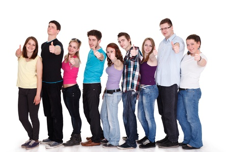 Group of smiling friends standing in row and showing thumbs up photo