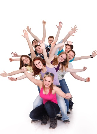 Smiling group of young friends having fun with outstretched arms Stock Photo
