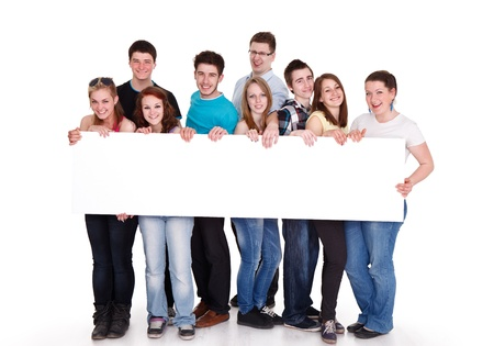 Group of young friends holding banner, isolated on white background  photo