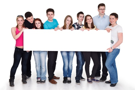 group of cheerful people holding a banner ad isolated over a white background photo
