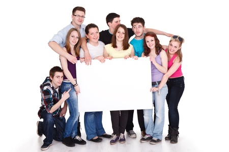 Happy smiling group of friends standing together in a row and displaying a white banner photo